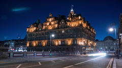 The Balmoral Hotel seen from North Bridge at night, Edinburgh - Night Time Lapse Stock Footage