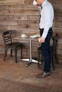 Businessman finishing drink in cafe Stock Photos