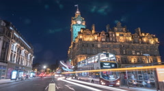 Night traffic on Princes street, near The Balmoral in Edinburgh - Time Lapse Stock Footage