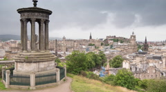 View over Edinburg and Dugald Stewart Monument in the foreground - Time Lapse Stock Footage