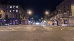 Night traffic on a street near Starbucks Cofe, Edinburgh - Night Time Lapse Stock Footage