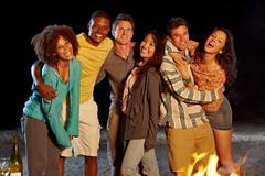 Friends having beach party at night Kuvituskuvat