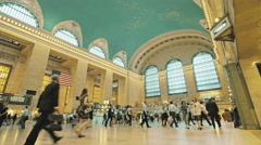 NYC Grand Central Station interior commuters people walk day New York City pan Stock Footage