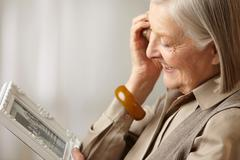Stock Photo of Senior woman holding picture frame