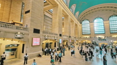 Grand Central Station interior NYC travel people walk day New York City panning Stock Footage