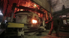 Worker operates in blast furnace workshop at the metallurgical plant Stock Footage