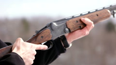 Man shooting with gun Slow Motion Close Up - stock footage
