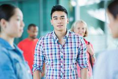 Young man in crowd Stock Photos