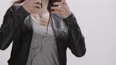 Digital Lifestyle - Young woman using headphones on her smart phone Stock Footage