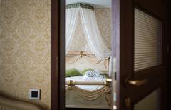 Half open door of a hotel bedroom Stock Photos