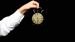 Hand hold alarm clock to keep on a palm. Time lapse Stock Footage