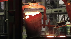 Worker on steel plant operates with  molten metal Stock Footage