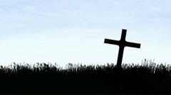 Cross in a field silhouette Stock Footage