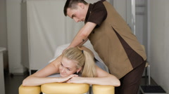 Woman in massage. Young attractive blonde woman smiling with a massage - stock footage