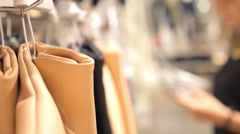 Beautiful Girl Shopping in Clothing Store Choosing Bag Stock Footage