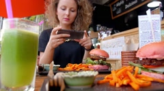 Woman Taking Picture of Veggie Burger with Mobile Phone in Healthy Cafe Stock Footage
