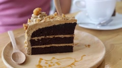 Eating Caramel Chocolate Cake with Fork in Cafe. Closeup Stock Footage
