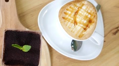 Cappuchino or Latte Coffe in White Cup with Tiramisu Cake Stock Footage