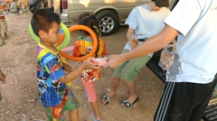 Youth Missions Team Handing Out Food To Asian Children In Slums Stock Footage