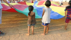 Asian Kids Love Playing With Parachute In Slums - stock footage