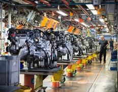 Workers on engine production line in car factory Kuvituskuvat