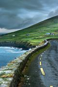 Paved road along rural cliffs Stock Photos