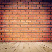 old red brick wall and wood floor with space - stock photo