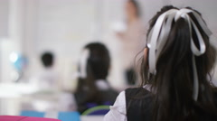 4K Happy school children in class listening to teacher & answering questions Stock Footage