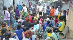 Youth Missions Team Handing Out Health Care Packages To Asian Slum - stock footage