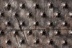 Ancient wooden spiked door detail i Stock Photos