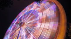 Ferris wheel at an amusement park at night with a slow shutter speed - stock footage