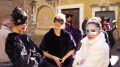 Young girl in carnival masks and costumes pose at Venice carnival. 4K - stock footage