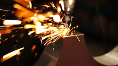 Finishing metal working on lathe grinder machine with flying sparks Stock Footage