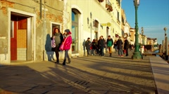 People walk along the promenade in Venice 4K Stock Footage