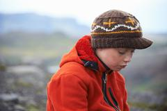 Girl wearing knitted cap outdoors Stock Photos