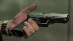 A gun being cocked close up Stock Footage