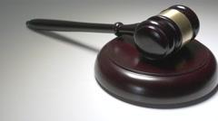 4K Judge Gavel Hammer & Sound Block Pan Over Stock Footage