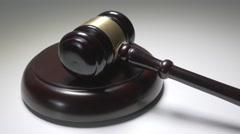 4K Judge Hammer Gavel on Sound Block Pan Stock Footage
