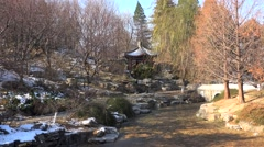 Outdoor pavilion near the frozen pond in the Beijing Zhongshan Park at winter Stock Footage