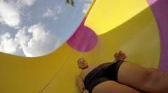 Happy Cheerful Man Sliding in Tube Water Slide in Waterpark. 2.7k Stock Footage