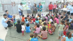 Youth Missions Team Sharing Gospel Message To Asian Slum Community - stock footage