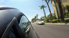 4K - driving by Mandalay Bay hotel casino Las Vegas strip Boulevard palm trees Stock Footage