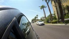 4K - driving by Mandalay Bay hotel casino Las Vegas strip Boulevard palm trees Stock Footage