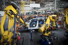 Robots welding car body in car factory Stock Photos