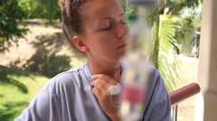 Female Patient with Iv Drip in Hospital Outdoors Stock Footage