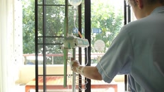 Young Sick Female Patient Looking in Hospital Window Stock Footage