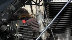 Hands Repairing the Engine of a Motorcycle. Stock Footage