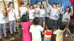Youth Missions Team Singing Fun Action Songs With Asian Children Stock Footage