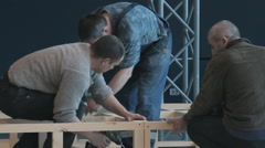 workers assemble wooden structures - stock footage