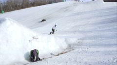 Snowboarder does 180 during big air contest Stock Footage